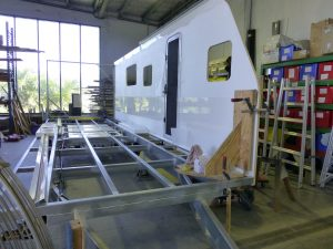 Assembling a composite panel kit to build a caravan shell